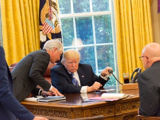 Sen. Bob Corker talks to President Donald Trump in the Oval Office.