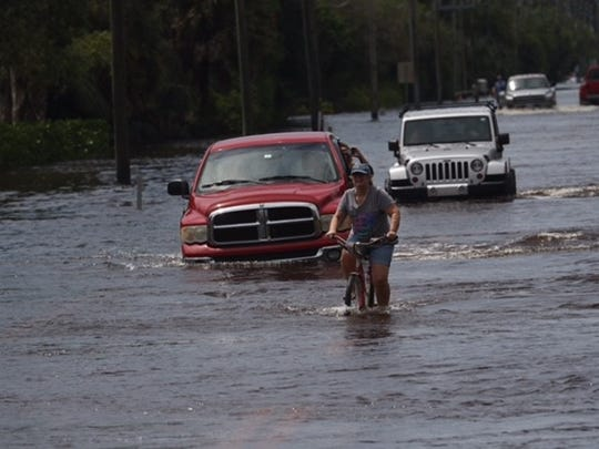 Roads were flooded in Island Park in south Fort Myers on Aug. 28, 2017, after days of rain caused evacuations and displaced residents from their homes.