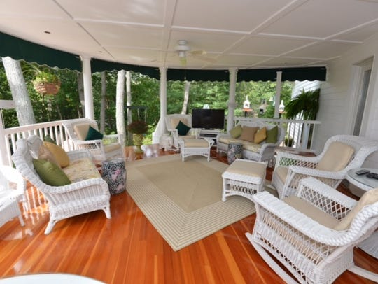 Enjoy the grand patio with hardwood flooring, perfect for entertaining.