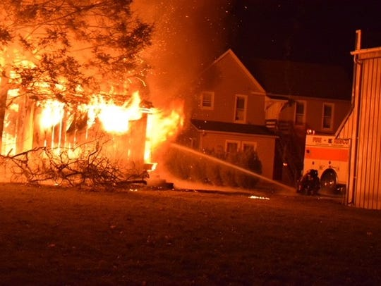 Firefighters battle a blaze at a Stewartstown garage