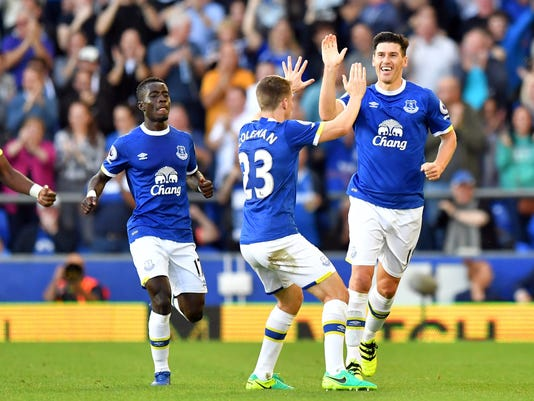 Everton's Gareth Barry, right, celebrates scoring his side's first goal of the game with teammates, during the English Premier League soccer match between Everton and Middlesbrough, at Goodison Park, in Liverpool, England, Saturday Sept. 17, 2016. (Dave Howarth/PA via AP)
