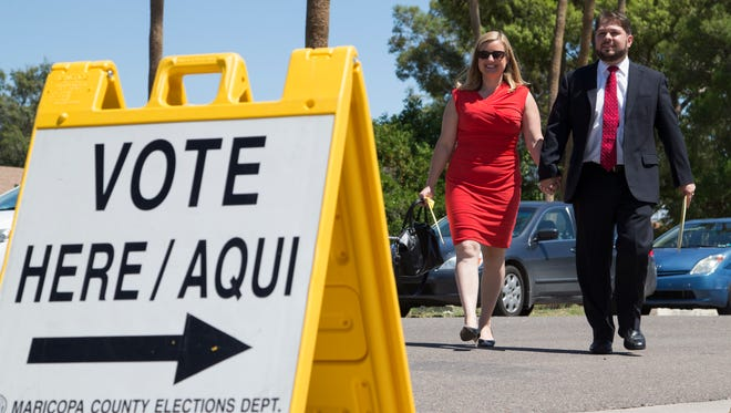 The turnout was light in Tuesday's 7th Congressional District Democratic primary, but winner Ruben Gallego and his wife, Phoenix Councilwoman Kate Gallego, voted, dropping off early ballots at Valley View School in Phoenix.