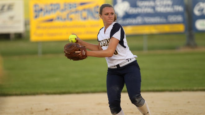 Regina's Kennedy Brown throws to first base during the Regals' first game against Mid-Prairie on Monday, June 1, 2015.  David Scrivner / Iowa City Press-Citizen