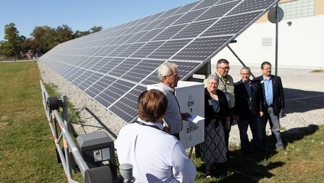 The Johnson County Board of Supervisors holds a ceremony for the new solar arrays at the secondary roads facility on Wednesday, Oct. 14, 2015.