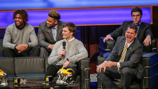 """New recruits Ahmir Mitchell, Kingston Davis, and Brandon Peters, look on as their new head coach Jim Harbaugh and Patriots QB Tom Brady have a laugh, during  the University of Michigan Athletic Department in partnership with The Players' Tribune and Carhartt special event, """"Signing of the Stars,"""" at Hill Auditorium on Wednesday, Feb. 3, 2016."""