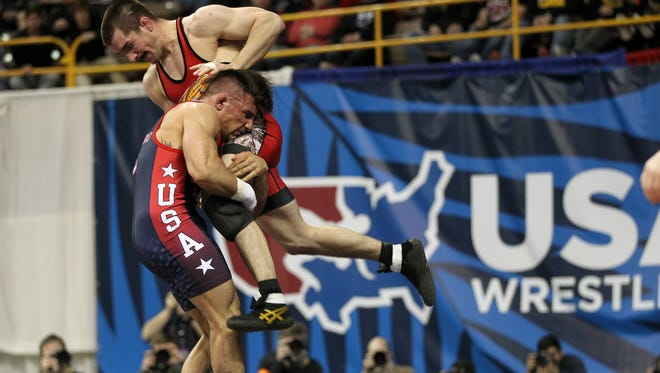 Former Hawkeye Brent Metcalf wrestles Frank Molinaro in the 143-pound (65 kilo) freestyle weight division at the U.S. Wrestling Olympic Team Trials at Carver-Hawkeye Arena on Saturday, April 9, 2016.