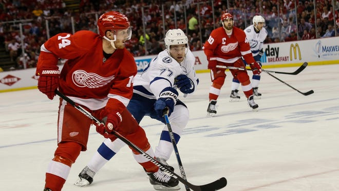 Detroit Red Wings' Gustav Nyquist controls the puck against Tampa Bay Lightning's Victor Hedman during second period of Game 4 at Joe Louis Arena in Detroit on Tuesday, April 19, 2016.