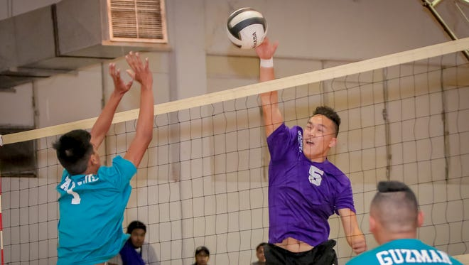 Devin San Agustin (5) of George Washington High School delivers a powerful spike against the Southern High School side.