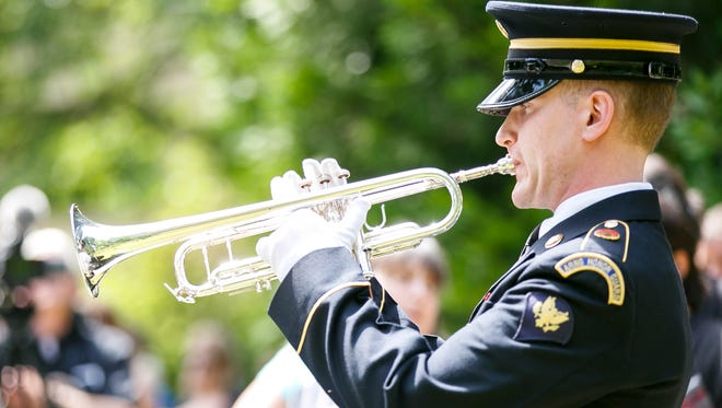 SPC Michael Banks with the 234th Army Band plays taps at last year's Memorial Day service on Monday, May 30, 2016, at the Oregon Department of Veterans' Affairs in Salem.