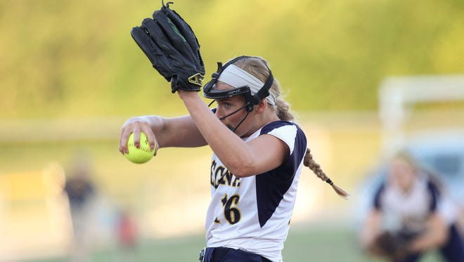 Regina's Sarah Lehman throws a pitch during the Regal's game against Cascade on Monday, June 20, 2016. Regina lost, 6-5, in eight innings.