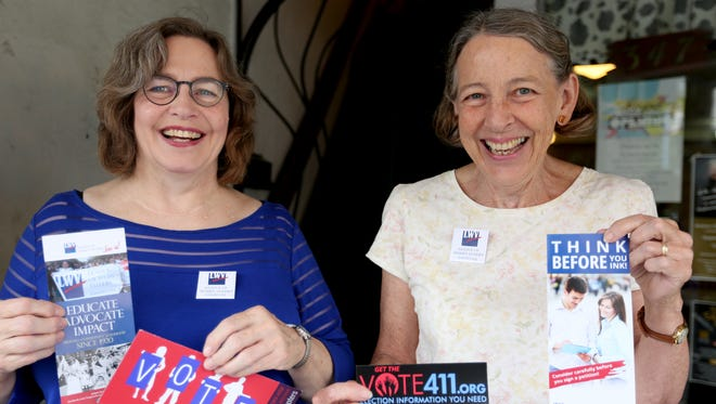 Cindy Burgess, left, and Kathleen West, with the League of Women Voters of Marion and Polk Counties invite people to come to a brunch at Roth's-West Salem on Sept. 10. Photographed during the Statesman Journal's Court Street Dairy Lunch in downtown Salem on Tuesday, Aug. 30, 2016.