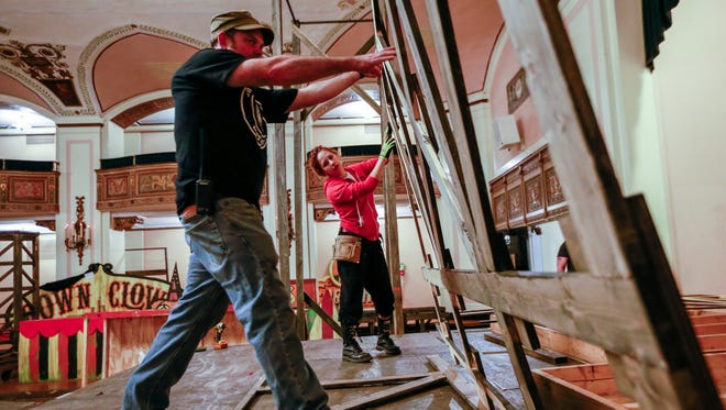 Matt Pomroy, of Ferndale works with Bridget Blondell, 23, of Detroit to build the stage set in the Crystal Ballroom in preparation for Theatre Bizarre at the Masonic Temple in Detroit, photographed on Monday, Oct.10, 2016.