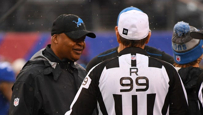 Dec 18, 2016; East Rutherford, NJ, USA; Detroit Lions head coach Jim Caldwell (L) talks with officials prior to the game against the New York Giants at MetLife Stadium.