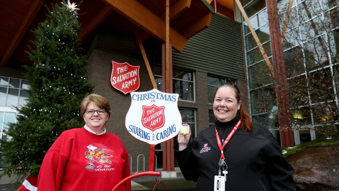 Major Tammy Ray, left, and Shannan Dailey, a public relations and marketing coordinator, show off a collectors coin valued at about $1,100 donated to a Willamette Valley red kettle at the Salvation Army Kroc Corps Community Center in Keizer on Monday, Dec. 19, 2016.