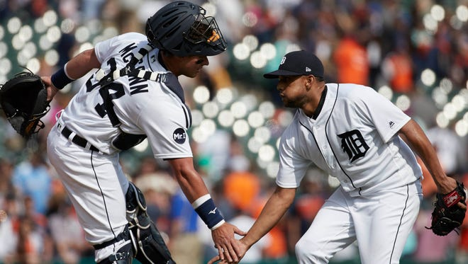 Tigers catcher James McCann (34) and pitcher Francisco Rodriguez (57) celebrate after the Tigers' 2-1 win Tuesday at Comerica Park.