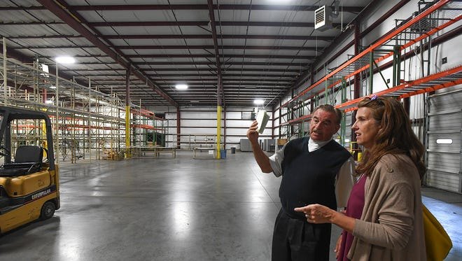 Developer Gary Faulkenberry and project director Traci Bryant-Riches look at what would be the gym of a new Chinese immersion school at a property in Taylors during a tour on Friday, September 9, 2017.