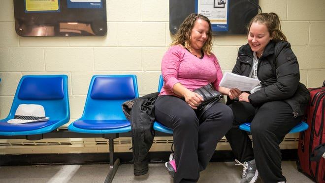 Shelly Theriault and her daughter, Laurren, 14, of Sarnia, figure out the time difference between Port Huron and Chicago, where they are traveling to see Katy Perry, while waiting to board the train at the Port Huron Amtrak station Oct. 25. Blue Water Area Transit is currently contracting with an outside firm to determine a potential new location or upgrades or repairs that can be done to the current station.