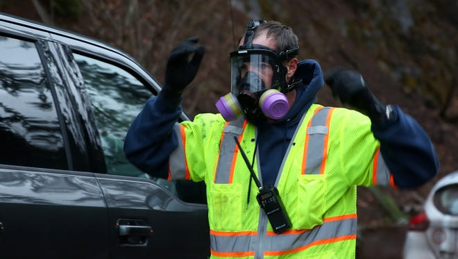 A technician wear a respirator as protection at the site of a fuel tanker truck crash on Highway 22 at milepost 63 on Monday, Dec. 18, 2017. Highway 22 remains closed from east of Detroit to Highway 20 near the Santiam Pass.