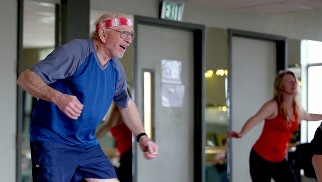Bob Zakes, 76, participates in a Zumba dance fitness class at the YMCA in downtown Salem on Monday, Jan. 8, 2018. Zakes is often the only male and one of the oldest people in the class.