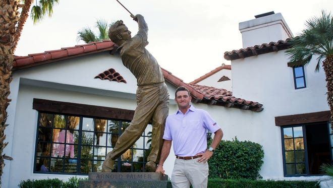 Sam Saunders stands next to a statue of his late grandfather Arnold Palmer following a ceremony Tuesday at Tradition Golf Club in La Quinta..