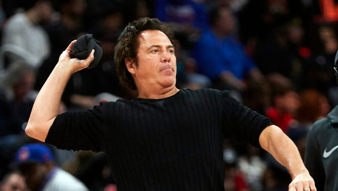 Detroit Pistons owner Tom Gores throws a shirt into the crowd during a timeout in the second half against the Toronto Raptors at Little Caesars Arena on April 9, 2018.