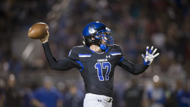 Quarterback Jacob Conover (17) of the Chandler Wolves throws during the 6A quarter-final football game between the Chandler Wolves and the Pinnacle Pioneers at Chandler High School on Friday, November 10, 2017 in Chandler, Arizona.