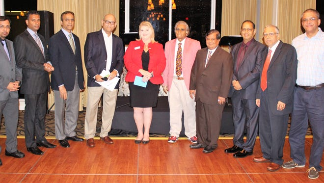 The Treasure Coast Indo-American Physician Society board of directors and executive committee present the American Red Cross with a $5,000 donation for Florida disaster relief. Pictured, from left, are Dr. Chintan Shah, Dr. Pramod Joseph, Dr. Baber Shareef, Dr. Bharat Upadhadya, Robyn Ducharme, Dr. Meghraj Thanvi, Dr. Darshan Shah, Dr. Lalit S.Chaube, Dr. Ramesh Nayyer, and Dr. Devang Patel.
