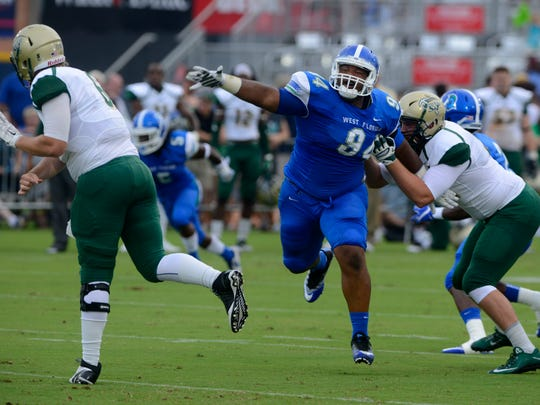West Florida's Anthony Ryals (94) goes after Missouri S&T's quarterback Tyler Swart Saturday agaisnt Missouri S&T during UWF's first home football game at Blue Wahoos Stadium.