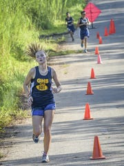 First place female, Guam High's Emma Sheedy finishes with a 25:34 in an Independent Interscholastic Athletic Association of Guam Cross-Country League meet between the Guam High Panthers and the Harvest Christian Academy Eagles at Nimitz Hill on Aug. 27. Sheedy will be competing at the 2016 Micronesian Championships in Pohnpei, FSM.