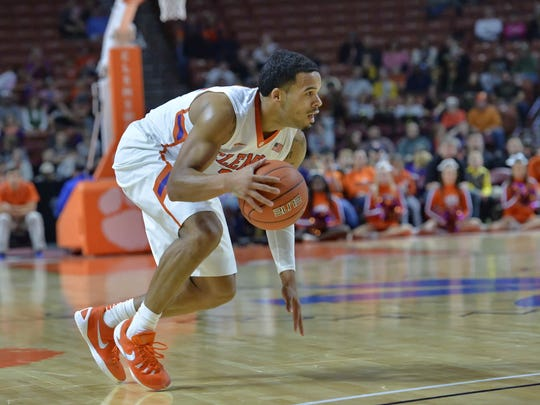 Clemson's Avry Holmes looks for a lane during the first half. Clemson hosted Wofford in men's basketball Sunday, Dec. 6, 2015 at BSWA.