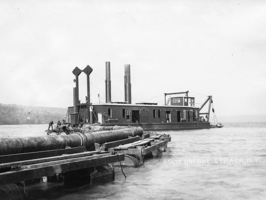 A dredging barge clears out sediment from Cayuga Inlet in this undated photograph.
