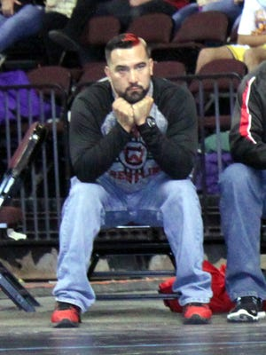 Jared Gallegos sits during the State Wrestling Championships in February, 2016, where his squad brought home a gold trophy.