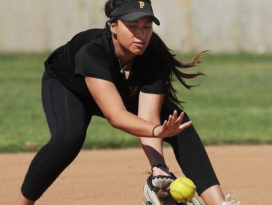 Newbury Park High shortstop Paige Barth fields a grounder