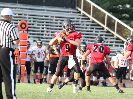 East Central quarterback Luke Patton prepares to deliver a pass against Lawrenceburg.