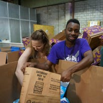 Louisiana College freshmen pack food boxes at the Food Bank of Central Louisiana.