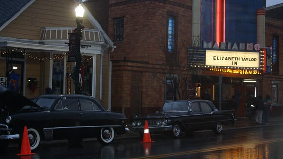 "Old cars lined the street in Bellevue Dec. 4 during filming of ""The Blunderer."""