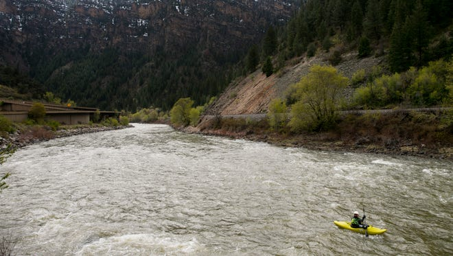 Kyle Clark of Grand Junction, Colo., kayaks the Shoshone section of the Colorado River in Glenwood Canyon outside of Glenwood Springs, Colo., on April 19, 2015. Lower snow packs in the mountains in recent years are reducing the amount of water in the Colorado River.