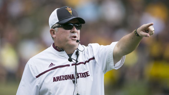 ASU head football coach Todd Graham shouts during an ASU football scrimmage at Camp Tontozona in the Tonto National Forest outside of Payson on August 15, 2015.