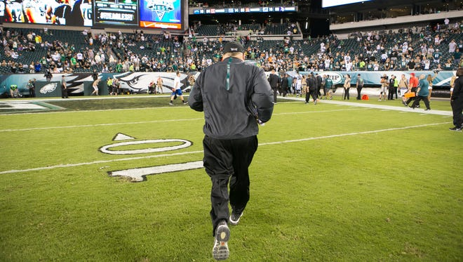 Chip Kelly, shown jogging off the field after a loss to the Dallas Cowboys on Sept. 20, has a 24-19 record as Eagles coach.