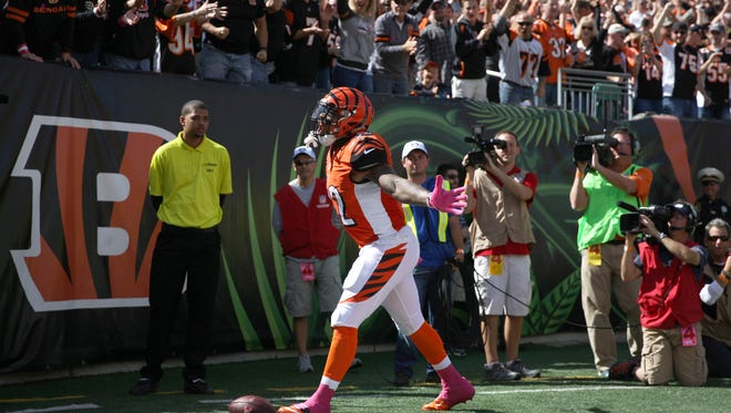 Bengals running back Jeremy Hill celebrates his 8-yard touchdown run in the first quarter.