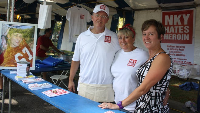 Nicholas Spect died at age 30 from a heroin overdose in August 2013 in his parents' Fort Thomas home, prompting his friends and family to create an organization called NKY Hates Heroin. Eric Specht, Nicholas' father, left, Karen Hillard of Independence and Joy Layman, Nicholas' aunt, stand at the group's booth at the Fort Thomas Merchants & Music Festival. A photo of Nicholas Spect, left, who died from a heroin overdose in August 2013 in his parent's Fort Thomas home, adorns the family's NKY Hates Heroin booth at the 11th Merchants & Music Festival in Fort Thomas' Tower Park Saturday, Sept. 27, 2014. From left are Eric Specth, Nicholas' father, Karen Hillard of Independence and Joy Layman, Nicholas' aunt.