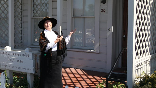 Mary Randall welcomes visitors to the First Mayor's House during the Founders' Day Celebration in March 2015.
