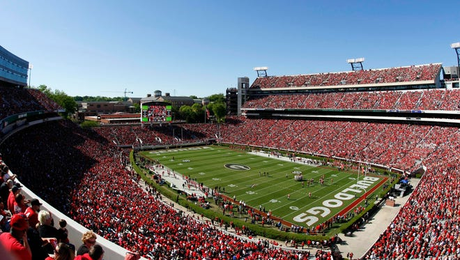 Massachusetts will get a basketball visit from Georgia as part of an agreement to play a football game at the Bulldogs' stadium (shown).