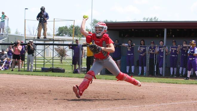Oak Harbor's Maddy Rathbun throws to third base last season.