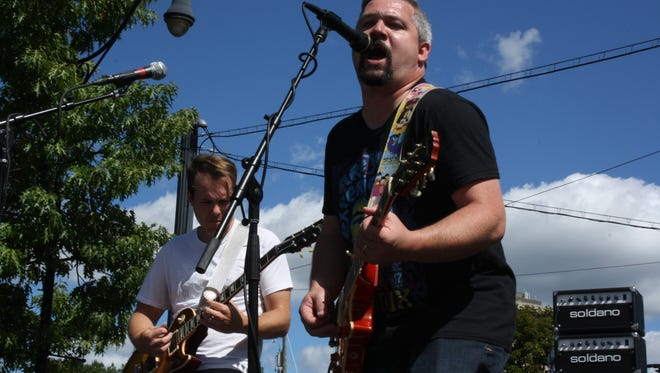 Nate Rogers, of the Egomaniacs, performs during the 15th annual Blues on the Bridge.