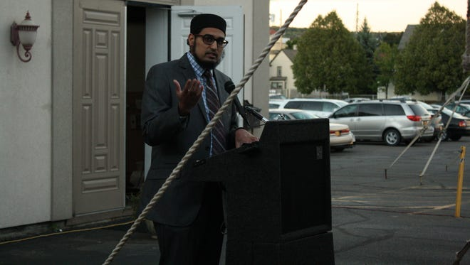 Imam Anas Shaikh, of the Islamic Organization of the Southern Tier, gives the closing address during the remembrance and peace vigil.