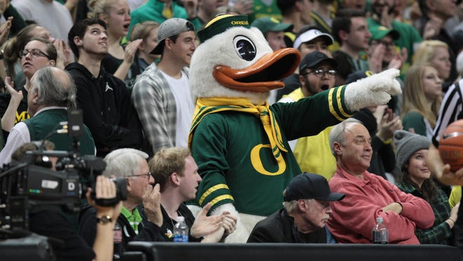 Dec 28, 2016; Eugene, OR, USA; Oregon Ducks mascot celebrates with fans against the UCLA Bruins at Matthew Knight Arena. Mandatory Credit: Scott Olmos-USA TODAY Sports