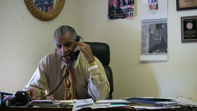Herman Holloway Jr. works in his office in New Castle.