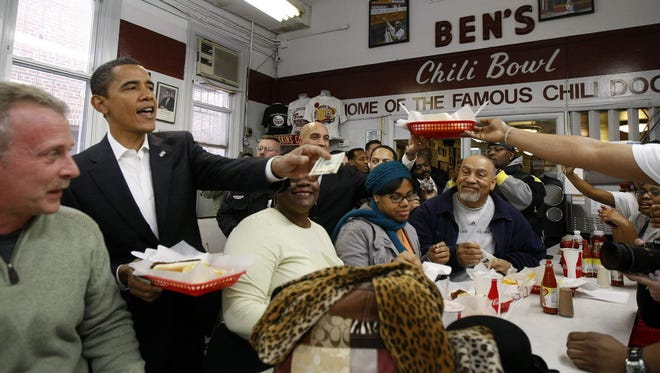 Then President-elect Barack Obama stops to eat in Ben's Chili Bowl in Washington, D.C. in January 2009.