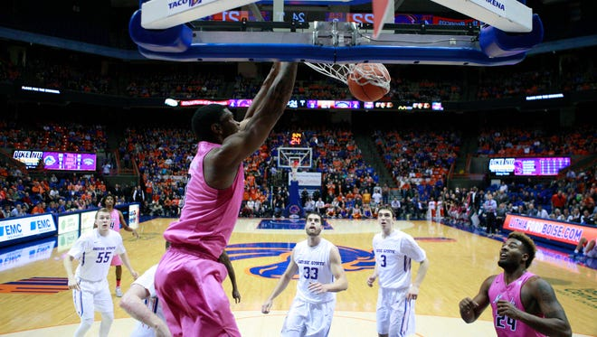 Wolf Pack forward Cameron Oliver finishes a dunk during the first half in a win over Boise State.